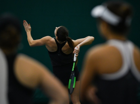 Mizzou tennis player Vivien Ábrahám leans back to serve the ball against Virginia Tech on Sunday, Feb. 3, 2019 at the Mizzou Tennis Complex. Abraham was the U18 national champion in doubles in her home country of Hungary. Liz Goodwin/Missourian