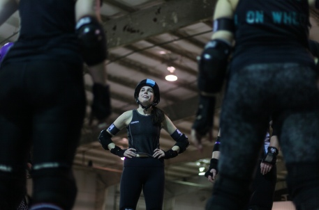 "Rebecca Heffron, who goes by the name of ""Code Monkey"" when in the roller derby rink, encourages her scrimmage team at the Bob Lemone building in Hallsville on Sunday, Feb. 17, 2019. The CoMo Roller Derby team splits into two separate squads to scrimmage during their practices. Liz Goodwin/Missourian"