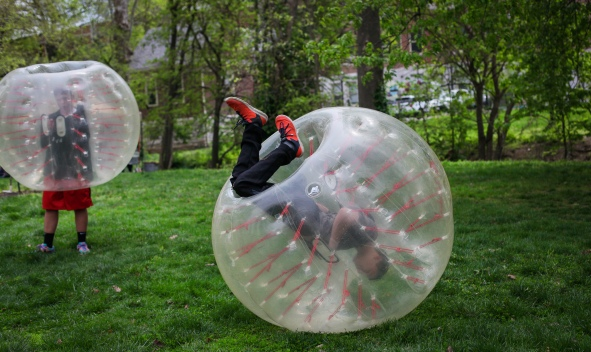 "Attendees of the Columbia Area Earth Day Festival clash in a ""Knocker Ball"" on Sunday in Peace Park. A Knocker Ball is an inflatable, single-chamber sphere that absorbs shock to your body."
